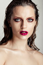 Hot young woman model with sexy bright red lips makeup strong eyebrows clean shiny skin and wet hairstyle beautiful fashion Stock Photo
