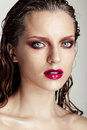 Hot young woman model with sexy bright red lips makeup strong eyebrows clean shiny skin and wet hairstyle beautiful fashion Royalty Free Stock Images