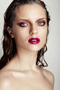 Hot young woman model with sexy bright red lips makeup strong eyebrows clean shiny skin and wet hairstyle beautiful fashion Royalty Free Stock Photos
