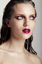 Hot young woman model with sexy bright red lips makeup strong eyebrows clean shiny skin and wet hairstyle beautiful fashion Stock Photography