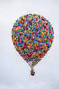 Hotair balloon a gorgeous multi colored in a blue sky Royalty Free Stock Images