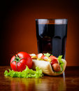 Hotdog and cola drink still life with vegetables Stock Photo