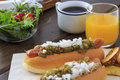 Hotdog with relish mustard and minced onion Stock Photography