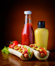 Hotdogs mustard and ketchup still life with traditional homemade Royalty Free Stock Images