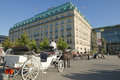 Hotel adlon berlin with horse carriage in on the street unter den linden on the place pariser platz wonderful view to the Royalty Free Stock Photo