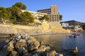 Hotel on the beach at sunrise in mallorca spain Stock Photos