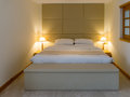 Hotel bedroom with double bed and lamps in in dubai united arab emirates Stock Images