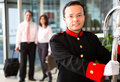 Hotel bellboy Stock Image