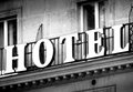 Hotel in black and white logo on a vintage building Stock Images