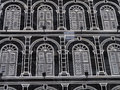 Hotel building windows background the decorated with white frames Royalty Free Stock Images
