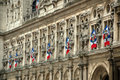Hotel de ville paris city hall or the in a landmark in covered in french flags Stock Images