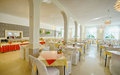 Hotel dining room spacious modern in with tables and buffet counter Royalty Free Stock Photo
