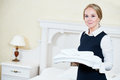 Hotel female housekeeping worker with linen Royalty Free Stock Photo
