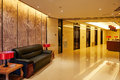 Hotel lobby and elevator doors furniture Royalty Free Stock Photo