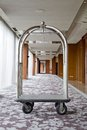 Hotel luxury trolley barrow silver chrome parked at walkway in h background Royalty Free Stock Images