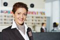 Hotel manager on reception happy female worker standing at Stock Photo