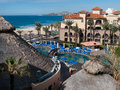 Hotel overlooking the sea of cortez hotels beach with vacationers and umbrellas in baja mexico near san jose on tourist corridor Stock Photo
