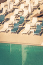 Hotel Poolside Chairs near a swimming pool Royalty Free Stock Photo