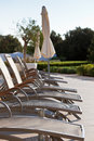 Hotel poolside chairs row vertical shot Stock Photography