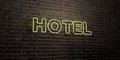 HOTEL -Realistic Neon Sign on Brick Wall background - 3D rendered royalty free stock image Royalty Free Stock Photo
