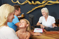 Hotel receptionist helping family to check in Stock Photos