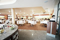 Hotel restaurant interior of spacious modern with counter in foreground Royalty Free Stock Photo