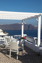 Hotel and romantic balcony on santorini island in the cyclades greece Stock Photos