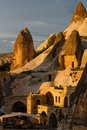Hotel rooms cut down in the rock light of setting sun cappadocia turkey Stock Photos