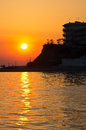 Hotel by the sea at sunset in greece Stock Photos