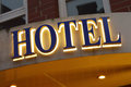 Hotel sign illuminated taken at dusk Royalty Free Stock Photography