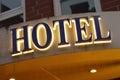 Hotel sign illuminated taken at dusk Royalty Free Stock Photography