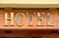Hotel sign made with golden letters over wood Royalty Free Stock Photos