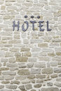 Hotel sign on a wall detail of an information signal three star Royalty Free Stock Photo