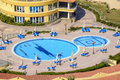 Hotel swimming pool empty under sunlight Stock Photos