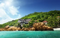 Hotel on tropical beach la digue seychelles Stock Photos