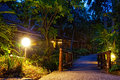 Hotel in tropics path shined with lamps Stock Photos