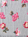 Houndstooth floral fabric from s decorative flowers on a black and gray pattern background Royalty Free Stock Image