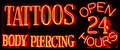 A 24 Hour Tattoo Parlor Neon Sign Royalty Free Stock Photo