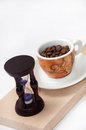 Hourglass and cup of coffe time for coffee coffee Stock Photography