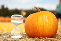 Hourglass and pumpkins holiday season countdown copy space Royalty Free Stock Image