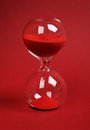 Hourglass on red background Royalty Free Stock Photo