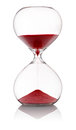 Hourglass with red sand running through Royalty Free Stock Photo