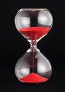 Hourglass with red sand running through the bulbs Royalty Free Stock Photo