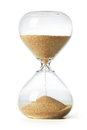 Hourglass with sand over white Royalty Free Stock Images