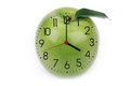 Hours against green apple with shooters Stock Images