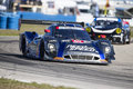 Hours of sebring fl mar the michael shank ford ecoboost need for speed car races through the turns at the at Stock Images