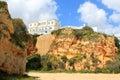 House in algarve praia da rocha or resort on the top of an ochre cliff portugal Stock Photos