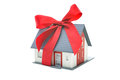 House architectural model with red bow real estate concept Royalty Free Stock Photo
