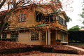 House in autumn a photo of an old with colorful leaves mount tamborine qld australia Royalty Free Stock Image