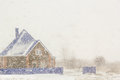 House on the background of plentiful snowfall a winter day Stock Photo